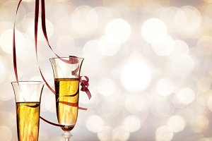 Two glasses of sparkling white wine and ribbons hanging.jpg