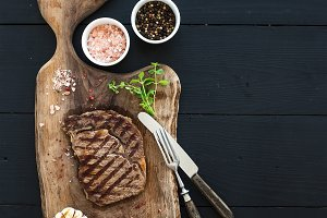 Grilled ribeye beef steak with herbs