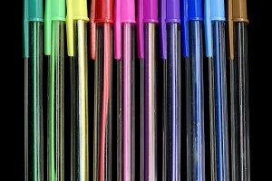 Colourful Neon Pens Against Black