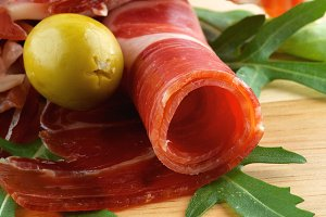Slices of Jamon and Olives