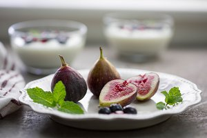 Fresh Figs on Plate with Yogurt Cups