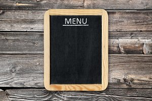 Menu board on wooden wall