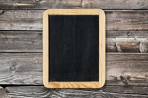 Blackboard on old wooden wall