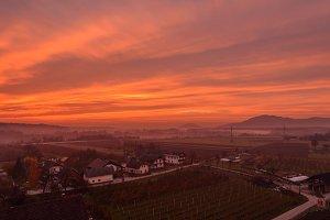 Dark orange sunrise over the town