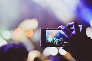 Girl recording video on a Concert