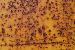 Rust Spots and Yellow Peeling Paint