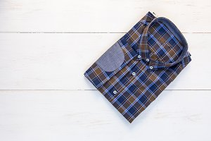 Shirt and scarf on wooden board