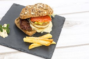 Burger with cheese, tomato, lettuce