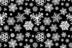 Different white snowflakes on black