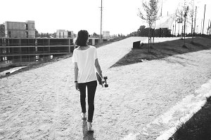 woman with a longboard, adventure