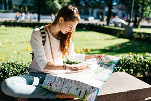woman exploring city with a map