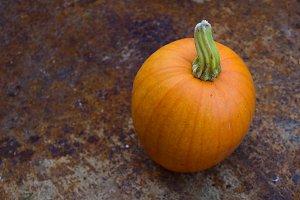 Autumn Pumpkin in Rusty Wheelbarrow