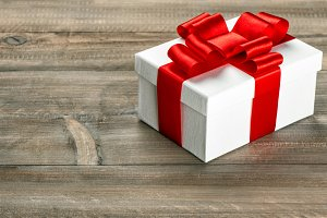 Gift box with red ribbon bow