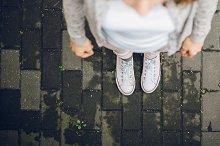 Woman feet in white sneakers