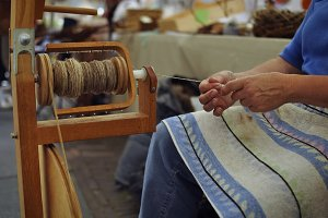 Woman working with spinning wheel