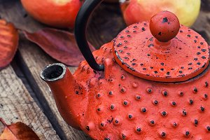 Stylish kettle and an apple