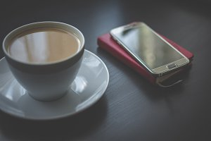 Coffee and smartphone on schedule 1
