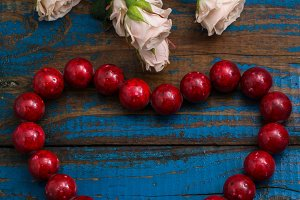 coral beads and rose