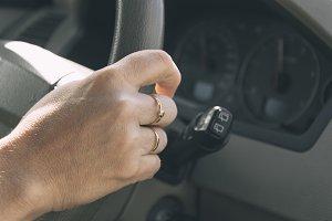 Woman hand driving a car