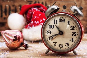 alarm clock and red Christmas cap
