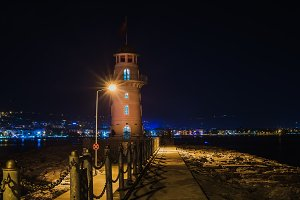 Lighthouse in the port at night