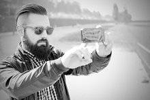 Hipster makes a selfie. BW