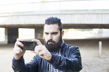 Hipster makes a selife.