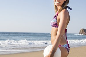 woman with beach volleyball ball