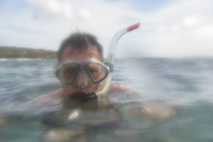Man snorkling in close up