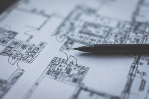 Pencil lying on technical drawing