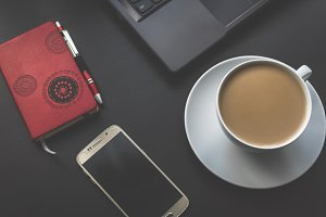 Smartphone, schedule and coffee