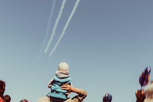The child looks airshow Plane