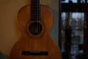 Vintage Parlor Guitar Showing Use