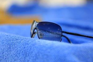Sunglasses on a blue towel