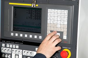 man hand  the controls of a machine