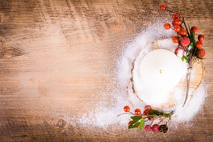 Candle, berries, snow, wood