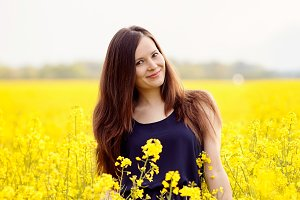 Smiling girl in yellow field