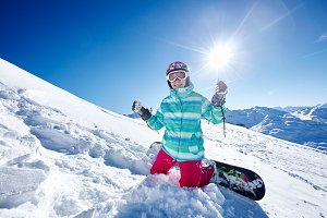 Happy snowboarder on piste