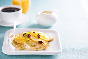 Thin crepes with citrus sauce