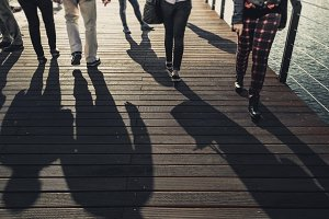 People Walking Along the Wooden Pier