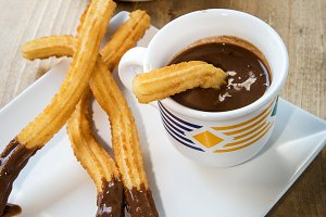 Churros with hot chocolate and sugar