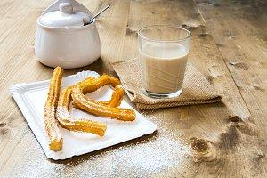 Churros with hot chocolate and sugar