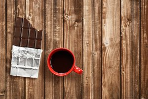 Chocolate bar and coffee cup