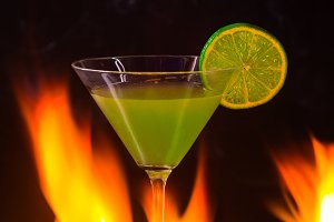 Burning alcoholic drink with ice
