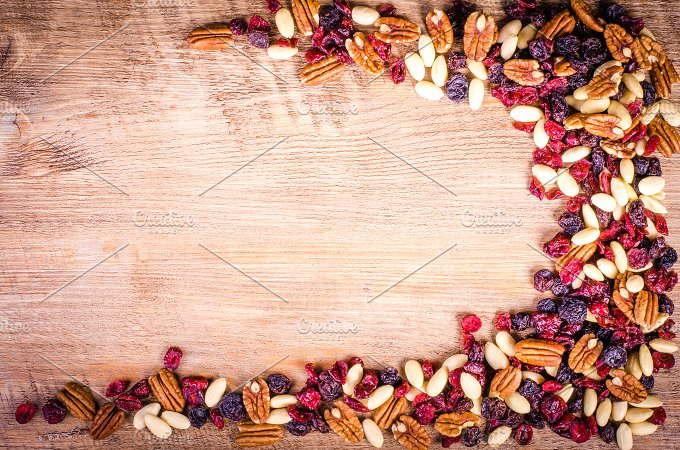 Dried fruits on wood. Food frame - Food & Drink