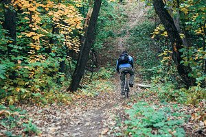 Man with bike in forest