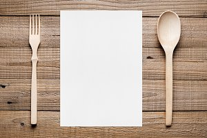 Paper for menu and fork and spoon