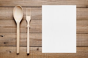 Blank menu and wooden fork and spoon