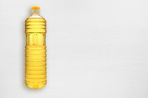 Bottle of sunflower oil on table