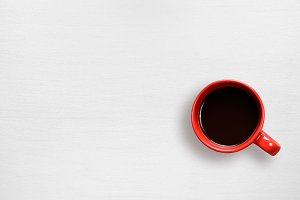Red coffee cup on white table